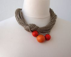 Ceramic necklace made from hemp.  I would prefer a subtler color of beads, probably gray or silver.
