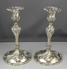 A pair of cast all silver candlesticks by Howard and Company of New York Circa 1896. The bases are not weighted at all and there is a script monogram and a date of June 25th 1896 discreetly engraved on the pedestal of each stick.