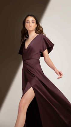 Meet Jenny Yoo's Raya gown for Fall 2020. Ceremony in the front, reception in the back, Raya's soft sleeves and open back is for the girl that can do both! Featuring a sassy V Neckline in Luxe Satin, a deep open back and a long full length A line skirt with a stunning leg slit. Shown in a sultry and decadent shade of burgundy called Mohagony. Loving this silhouette of effortless and chic, but surely memorable. Jewel Tone Bridesmaid, Bridesmaid Dresses, Bridesmaids, Shades Of Burgundy, Convertible Dress, Mob Dresses, Satin Fabric, A Line Skirts, Dress Making