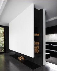 caminetto a legna da pavimento con quinta e nicchia laterale per riserva legna