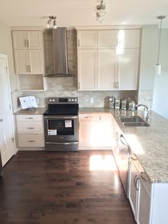 Beautiful Kitchen Design With Off White Cabinets Light Beige Granite And Soft Light Brown Brick