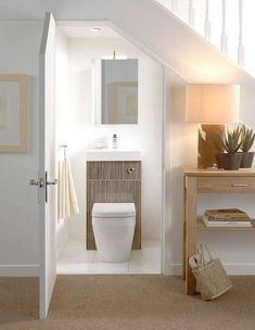 Did you know you could turn an under stairs space into a small bathroom? Just install a cute toilet sink combo and add a mirror above it. Small Downstairs Toilet, Small Basement Bathroom, Bathroom Under Stairs, Small Toilet Room, Tiny Bathrooms, Bathroom Ideas, Downstairs Bathroom, Toilet Under Stairs, Bathroom Plumbing