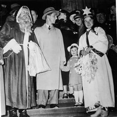 Nazi propaganda minister Josef Goebbels and his daughter with Christmas revelers, 1935. Although the Nazis were virulent anti-religion, they continued to make Christmas a national day of events and general merriment for obvious reasons.