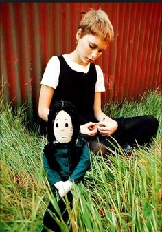 Mia Farrow and her Wednesday Addams doll share a pensive moment