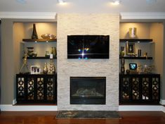 Idea for fireplace -- TV over top, add on to make it the whole wall