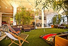Bay Area start-up Tune-up Media, known for its magical music library iTunes plug-in, worked with designer Marc Hinshaw to create the ultimate rock 'n' roll workspace in a 8,700-square-foot warehouse-turned-office in Potrero Hill. Here, there's a Golden Gate Park inspired lounge, complete with faux grass and deck chairs.