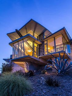 Beautiful modern home with incredible view at night.