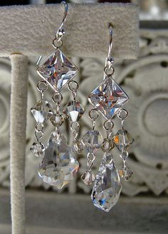 Swarovski Clear Crystal Chandelier Earrings 11 Main:  Features:Authentic Swarovski Clear Crystals (Baroque Pendants)Chandelier StyleSterling Silver French WireCZ CenterpieceSilve...