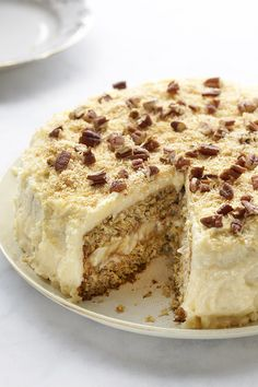 This banana coconut cake recipe is so moist it melts in your mouth. Between the two layers of scrumptious cake lies a sweet coconut frosting.