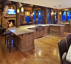 Kitchen island with seating area. Love the cabin feel