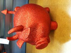 Cute piggy bank and its red