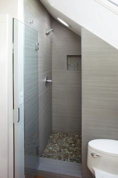 Large tile in small area, it is all in the well done layout (grout line). Modern bathroom by Mueller Nicholls Cabinets and Construction