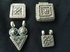 Ethiopian antique silver telsums,protective amulets. done in very skilled file grain work,