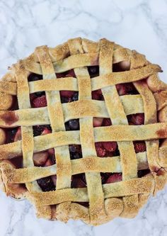 Mixed Berry Pie - juicy blueberries, strawberries, and black berries in a buttery, flaky pie crust!   BlahnikBaker.com