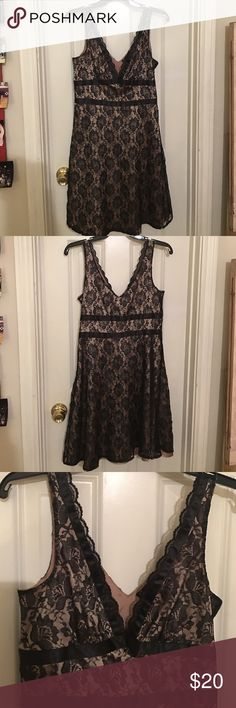 Beautiful Black and Gold Lace Dress Great for formal wear or fancy get-together. Has a side zipper that is fully functional. Black Lace is layer over a gold silky lining. Great condition. Forever 21 Dresses Mini