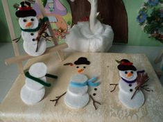 Make a snowman with cotton discs