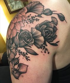 Blackwork floral tattoo (dahlia roses ginkgo calla lilies & more) with dotwork and whip shading by Jacob Kearney at Metamorph Tattoo Chicago