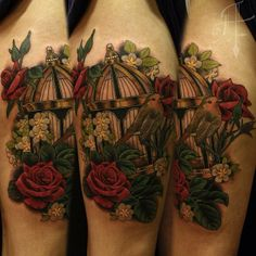 Beautiful floral bird cage with small bird tattoo by @antonyflemming