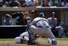 Game #111 8/5/12: San Diego Padres' John Baker, left, beats the tag of New York Mets catcher Josh Thole while scoring on a double by Mark Kotsay during the eighth inning of a baseball game on Sunday, Aug. 5, 2012, in San Diego. (AP Photo/Lenny Ignelzi)