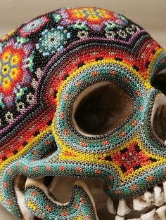 Huichol Art, Mexico - DIY on plastic skull with small beads and mod podge for headband storage (: by terrie
