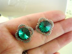 Maeve--Swarovski Emerald rivoli crystal ox antique sterling silver plated solid brass ear posts. $20.00, via Etsy.