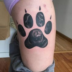 Paw print tattoo by NorCal Tattoo