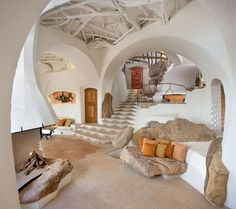 cave living. I would so not mind being a neanderthal if i could live in this kind of cave!!!