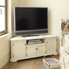 Stylish and practical modern TV stand designs are more numerous than you may think is a necessity, so having a flexible entertainment center is a great idea.This space-saving corner media console holds up to a 46 screen at just the right height for family Corner Media Cabinet, Corner Dresser, Corner Tv Console, Corner Tv Cabinets, Tv Unit Furniture, Home Decor Furniture, Furniture Plans, Cabinet Furniture, Corner Unit Tv Stand