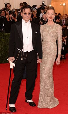 Johnny Depp and Amber Heard; I'm pinning this because I love Amber's dress. I think it's gorgeous.