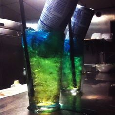 Irish Trashcan! 1/2 oz gin, 1/2 oz light rum, 1/2 oz vodka, 1/2 oz peach schnapps, 1/2 oz Blue Curacao liquor, 1/2 oz triple sec, 1 can Red Bull energy drink. Fill glass with ice, then add all liquors and stir. Add full can of Red Bull. The can will float and slowly seep down the glass, turning the mix green, hence the name Irish Trashcan.