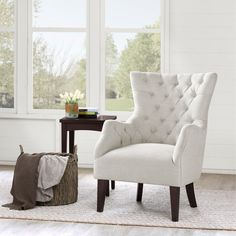 Hannah Wing Chair is constructed using only the finest materials. The frame is constructed using solid hardwood, the seating is webbing. The flared wing look has a hand tufted back. The tight seat design only adds to the look.