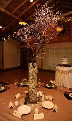 Fun DIY tall vase centerpieces with wine corks and manzanita branches // Chasing Lilies Photography
