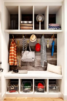 Mudroom storage. I like the natural board backing- NYTimes.com