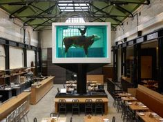 Life imitates art at Mark Hix's Tramshed restaurant in Shoreditch where Damien Hirst's formaldehyde tank doubles up as a reminder of the menu.