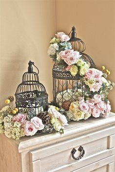 stunning – use silver birdcage, add in candles in the center and small votives around – could use as a centerpiece