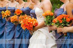 Orange flower bouquets with blue bridesmaid dresses