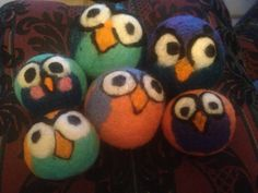 4 felted wool dryer balls. Custom size package and colors.  Happy hoppin' hooter owls. Save time, money and energy