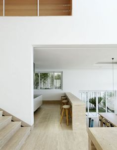 love the little wall and stools. c house ++ archipelago architects