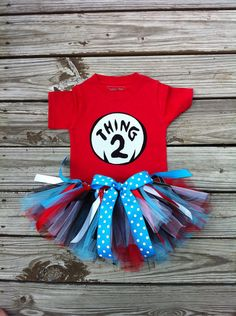 Custom boutique. Applique choice of Dr.Seuss Thing 1, Thing 2, Thing 3 shirt set with scrappy tutu. By EverythingSorella. $48.50, via Etsy.