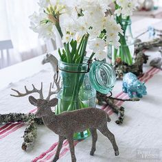 We love DIY ideas like this! Make an easy tablescape with stunning flowers like paperwhites, that make the perfect centerpiece when stuffed into blue Mason jars. Complete the festive look with painted toy animals.
