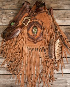 The Buffalo Girl classic - Apache Tasseled Bag with high Grade Turquoise, featuring our signature brass Eagle buckle, feather strap & a matching leather clip. Deliciously golden tones, careful carving & abundance of tassels. Leather Fringe, Leather Tooling, Leather Purses, Suede Leather, Leather Handbags, Fringe Purse, Fringe Bags, Crescent Lake, Western Purses