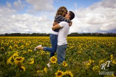 Engagement Photos | Engagement photos in a sunflower field! So beautiful!