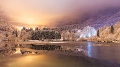 Snowy night on Lake Lenna in the Brembana Valley, north of Italy