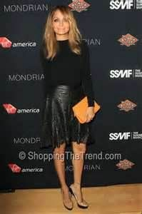 When I saw Nicole Ritchie in this outfit I thought it was one of her best looks. This is a leather skirt by her own line, Winter Kate. The camel clutch is a perfect contrast! Love!