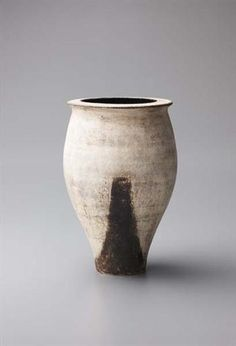 HANS COPER Early vase with painted foot and angled lip. 1952.