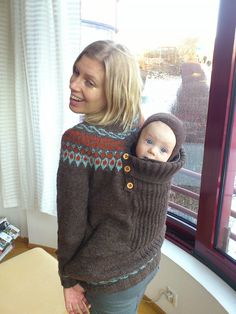 Baby-wearing sweater.