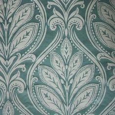 Ryecote Damask Fabric A classic damask fabric with a satin texture in silver on aqua.
