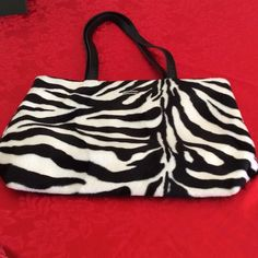 Zebra Print Tote Exterior plush feel, interior zip middle section with 2 open sides and smaller zip section, faux leather handles, great condition Bags Totes