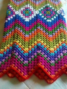 fun granny ripple blanket.....could do in more neutral colors for an ethnic look.....grey and black and white with a little red for example....