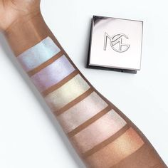 http://www.revelist.com/beauty-news-/makeup-geek-highlighters/5351/These are the brand-new Makeup Geek Duochrome Highlighters. That's right: an entire LINE of rainbow highlighters!/2/#/2
